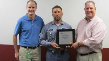Mark Suellentrop, right, Cabot facility general manager