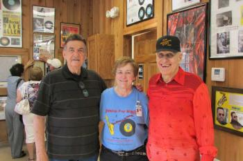 "Louisiana Swamp Pop Museum Director Janie Knighten meets with an old friend, BJ ""Boo Boo"" Boulet, left, who is a featured musician in the museum, and his cousin, Bobby Page, right."