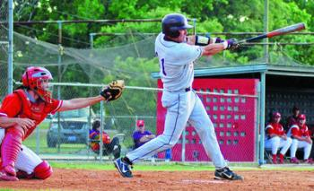 LYLE CHAMPAGNE (right) of Breaux Bridge takes a break after reaching first base on a single against Opelousas last week.