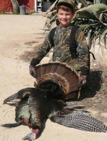 Benjamin Tauzin, 8, with the Rio Grande gobbler taken on his first ever hunt.<!--break--> The bird had inch-and-a-half spurs and a nine-inch beard and weighed 17 pounds field dressed. Benjamin was hunting in Sonora, Texas, with his grandfather, Donald Tauzin.