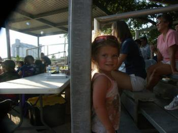 Ella Guidry doesn't seem to care too much about the baseball game going on behind her at Bronco Field in Crowley Tuesday afternoon.
