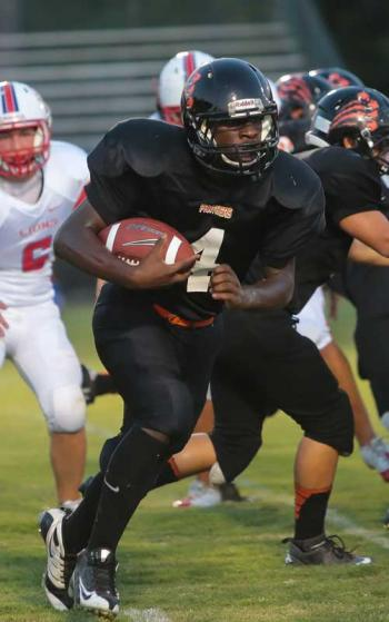 Douglas Fontenot takes a handoff and looks for yardage in a game from earlier in the year.